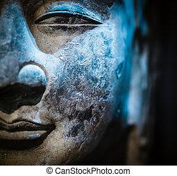 ancient stone buddha closeup - ancient stone sculpture of...