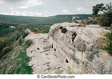 Ancient stone caves in a town-fortess Eski-Kermen high in a rocky mountains, Crimea. Top view.
