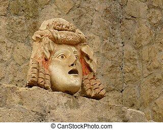 Ancient stone mask at Herculaneum, Italy