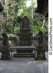 Ancient stone sculpture in the Balinese jungle
