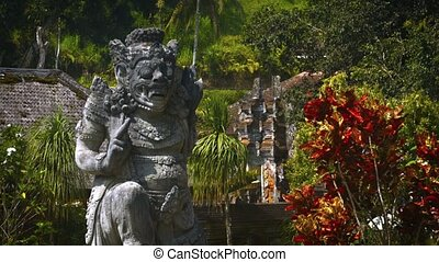 """Ancient Stone Sculpture inside Tirta Empul Temple in Bali, Indonesia"""