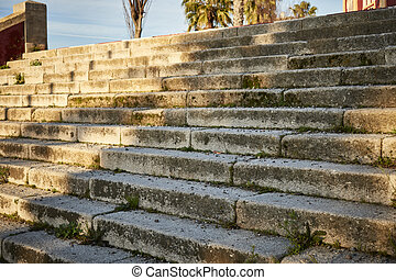 Ancient stone stairs illuminated by the sun and with shadows