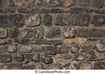 Ancient stone wall. Brawn weathered brick background or texture