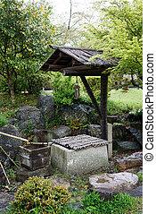 ancient stone well in japane garden