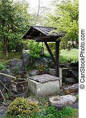 ancient stone well in japane garden