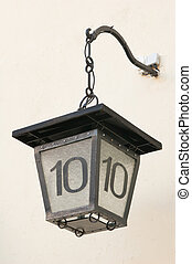 Ancient street lantern with number ten