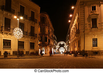 Ancient streets of Syracuse (Siracusa, Sarausa) at night-- historic city in Sicily, Italy