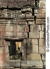 Ancient temple wall - old stone facade