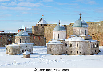 Ancient temples of the Ivangorod fortress in the March afternoon. Ivangorod, Russia
