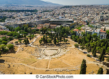 Ancient theater of Dionysus ruins and Athens panorama.