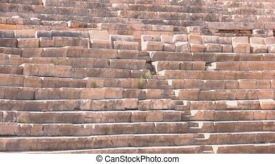 Ancient theater of Greek town Antiphelios. Old amphitheater in Kas, Turkey. Historical architecture.
