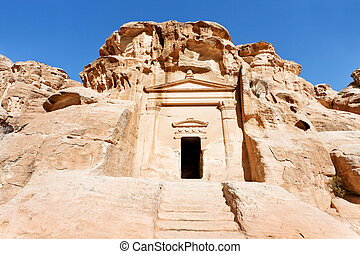 ancient tomb near the entrance in Little Petra