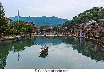 Ancient town Fenghuang at sunset in Hunan China