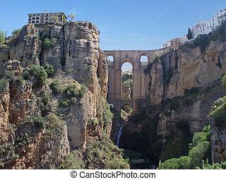 Ancient Spanish town Ronda with beautiful bridge between cliffs
