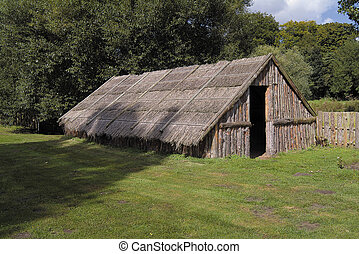 Modern reconstruction of thatched dwelling of Iceni tribe from East Anglia region of Britain