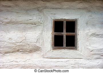 Ancient Ukrainian window. House in authentic village. Ukraine, Kiev, Porogovo