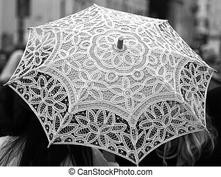 ancient umbrella all hand-decorated with lace doilies