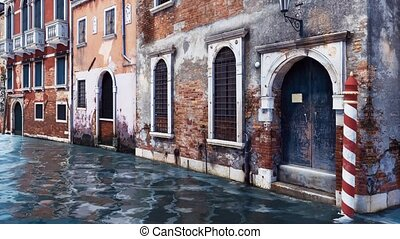Ancient venetian buildings along the water canal - Ancient...