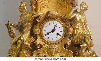 Ancient vintage brass pendulum clock. Vintage gold watch