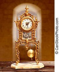 ancient vintage golden brass pendulum clock