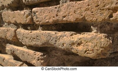Ancient wall and sunlight. Damaged bricks and cement....
