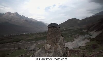 Ancient watchtower in City of the dead in Upper Balkaria, caucasus Russia
