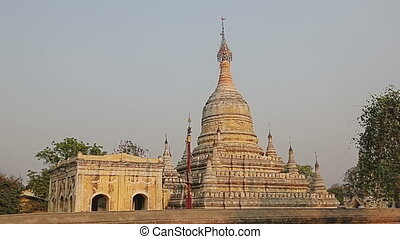 Ancient white pagoda - Ancient white temple in Bagan at...