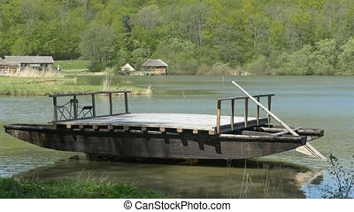 Ancient Wood Ferry-boat - Old rural wood ferry boat for...