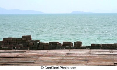 ancient wood on surface of walkway and blur sea background