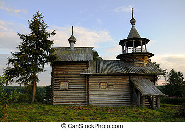 Ancient wooden christian church on a hill