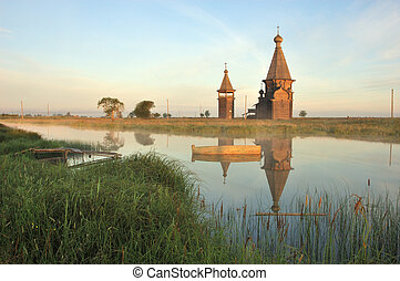 Ancient wooden church at sunrise