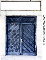 Ancient wooden door in stone castle wall.