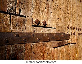 Ancient wooden door in Valencia Torres de Serranos