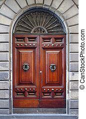 ancient wooden door of historic building