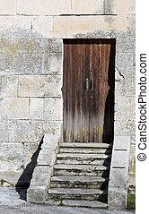 ancient wooden door to enter in the belltower