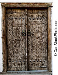 Ancient wooden door - Wooden door with ancient floral...