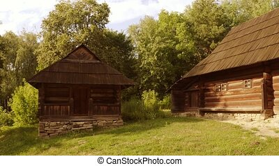 Ancient wooden medieval cabin houses. Old rustic shacks in a...