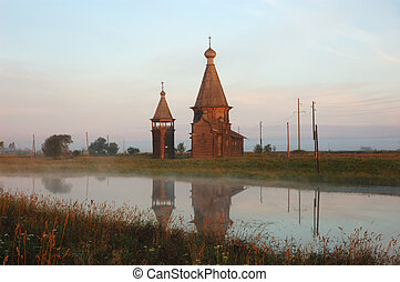 Ancient wooden russian church at sunrise