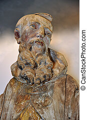 ancient wooden sculpture of Cyprian - famous monk in Red Cloister (slovak: Cerveny klastor), Slovakia