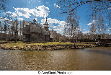 Ancient wooden temple stands on the banks of the river