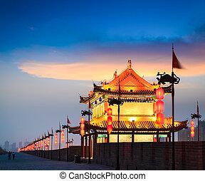 beautiful ancient tower on city wall in nightfall at xian, China