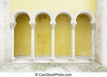 Ancient yellow arches in the Palacio da Pena - Ancient...