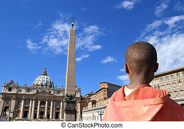 Image of an immigrant child who looks at the Vatican