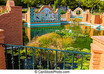Andalusian style nice pond in the park of Malaga, Spain