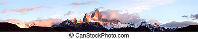 Andes in the fire. Giant panorama of mountain range Fitz Roy...