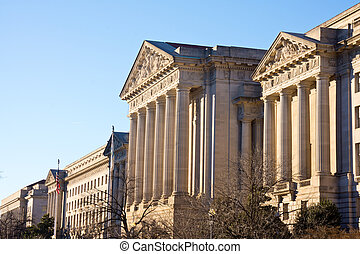 Andrew Mellow Auditorium in Washington DC.  It has Neoclassical design with columns and intricate detail.  It was completed in 1935.