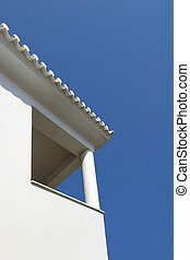 White minimal geometrical architecture of Cyclades. City of Andros on Andros island - building detail on blue sky.
