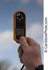 Anemometer in the hand of man,  wind speed 11.8 ms . Clouse-up