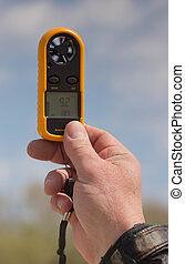 Anemometer in the hand of man,  wind speed 9,2. Clouse-up