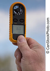 Anemometer in the hand of man,  wind speed 16.0 ms . Clouse-up